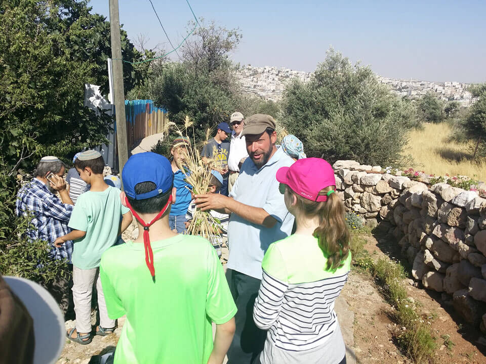 Parents and children of all ages enjoy The Hebron Fund tour with Rav Simcha Hochbaum