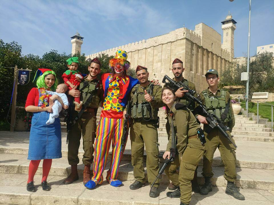 Soldiers and Residents pose with Purim clown