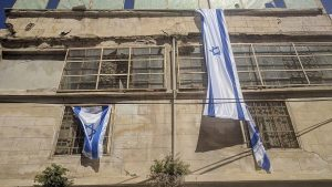 Israeli flags drape Bait Leah amidst residents' recent move back