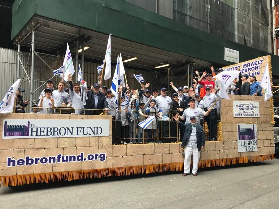 Hebron Fund supporters enjoy the parade from the Hebron Fund float