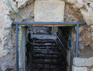 Refurbished entrance to the tomb complex courtyard.