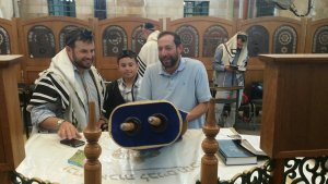 Bar mitzvah boy reads torah scroll in Ma'arat HaMachpela