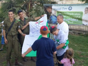 Bar Mitzvah boys get flag from Hebron soldiers