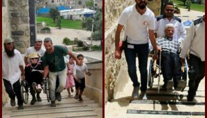 People in wheelchairs are carried up the long staircase to enter Ma'arat HaMachpela